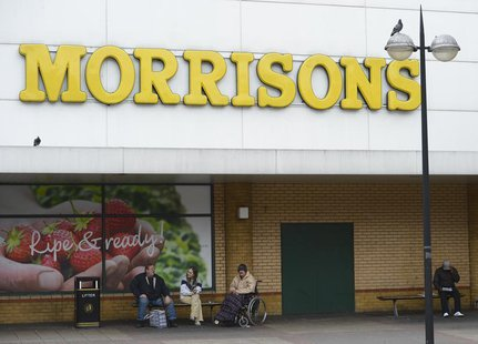 People sit outside a Morrisons supermarket in Stratford, east London, May 17, 2013. REUTERS/Paul Hackett