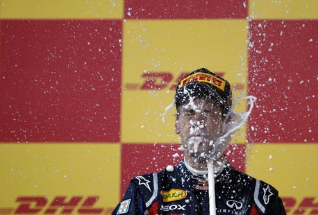Red Bull Formula One driver Sebastian Vettel of Germany celebrates winning the world championship after finishing third in the Japanese F1 G