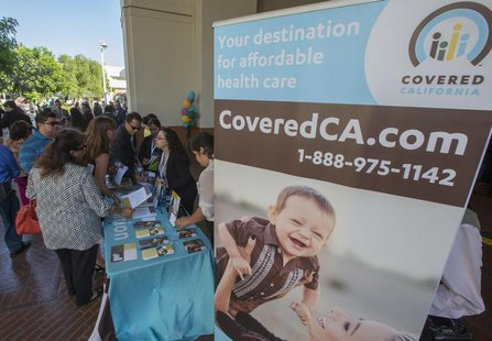 People sign up for health insurance information at a Covered California event which marks the opening of the state's Affordable Healthcare A