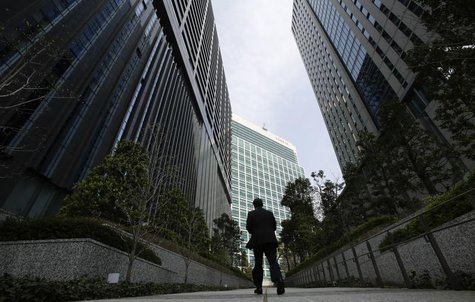 A businessman walks in Tokyo's business district April 1, 2013. REUTERS/Toru Hanai