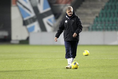 Estonia's national soccer team head coach Tarmo Ruutli plays with the ball as he attends a training session in Tallinn November 10, 2011. RE
