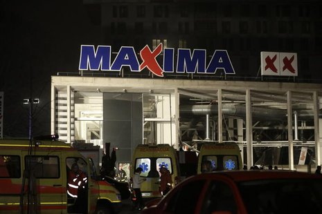 Ambulances are pictured parked near a store with a collapsed roof in Riga November 21, 2013. REUTERS/Ints Kalnins