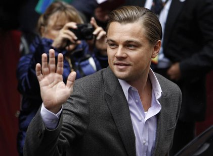 "Actor Leonardo DiCaprio waves to supporters as he arrives for a photocall to promote the movie ""Shutter Island"" at the Berlinale Internation"