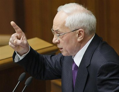 Ukraine's Prime Minister Mykola Azarov gestures during a session of the parliament in Kiev April 19, 2013. REUTERS/Gleb Garanich