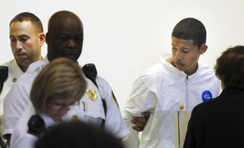 Philip Chism, 14, stands during his arraignment for the death of Danvers High School teacher Colleen Ritzer in Salem District Court in Bosto