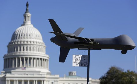 "Demonstrators deploy a model of a U.S. drone aircraft at the ""Stop Watching Us: A Rally Against Mass Surveillance"" near the U.S. Capitol in"