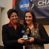 Hope College L Jayne Kessel (R) receives the NCAA Elite 89 award during ceremonies at Holland's Haworth Inn on Nov. 20, 2013.