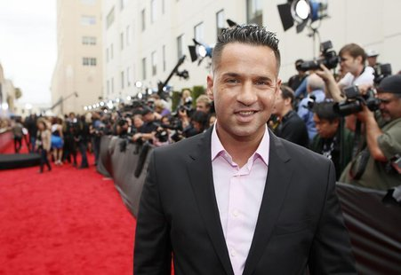 Television personality Mike Sorrentino arrives at the 2013 MTV Movie Awards in Culver City, California April 14, 2013. REUTERS/Danny Molosho