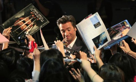 "Actor Hugh Jackman signs autographs for fans at a red carpet event for the Japan premiere of ""X-men Origins: Wolverine"" in Tokyo September 3"