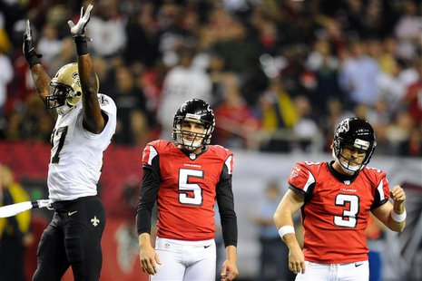 Nov 21, 2013; Atlanta, GA, USA; New Orleans Saints safety Malcolm Jenkins (27) and Atlanta Falcons punter Matt Bosher (5) and place kicker M