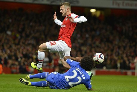 Arsenal's Jack Wilshere (top) is challenged by Chelsea's Willian during their English League Cup fourth round soccer match at Emirates Stadi