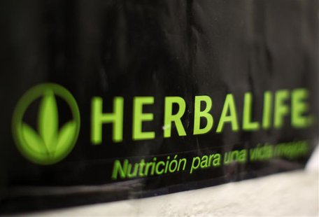 An Herbalife logo is shown on a poster at a clinic in the Mission District in San Francisco, California April 29, 2013. REUTERS/Robert Galbr