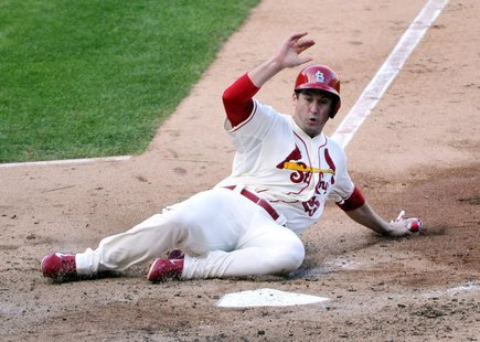 Oct 12, 2013; St. Louis, MO, USA; St. Louis Cardinals third baseman David Freese (23) scores a run against the Los Angeles Dodgers during th