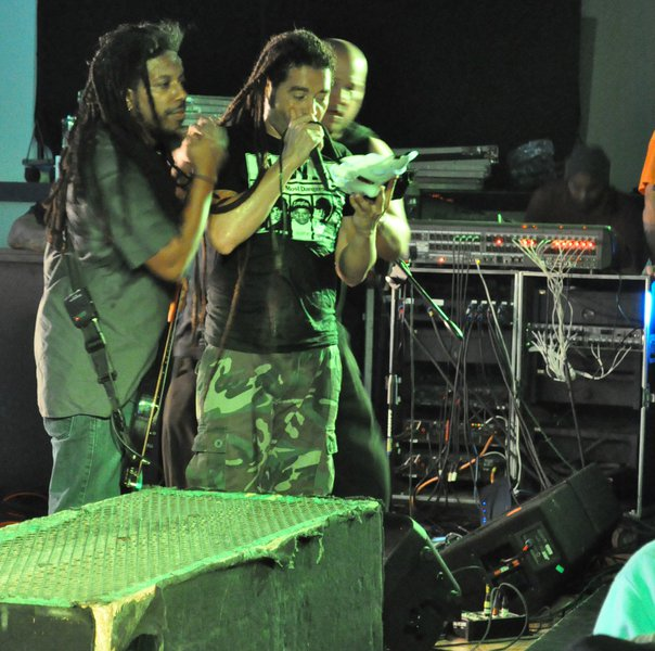 Nonpoint checking out a wallet that was thrown on stage, before returning it to the owner