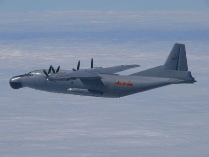 A Chinese military plane Y-8 airborne early warning plane flies through airspace between Okinawa prefecture's main island and the smaller Mi