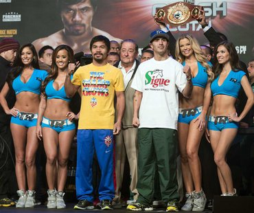 Brandon Rios (2nd R) of the U.S. and Manny Pacquiao (front, 3rd L) of the Philippines pose after an official weigh-in for their World Boxing