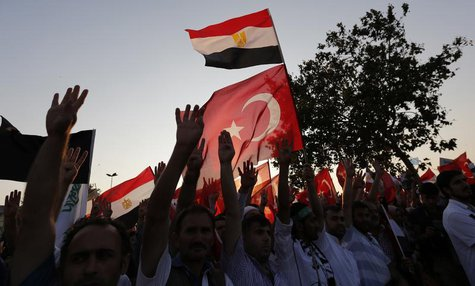 Supporters of Egypt's deposed Islamist President Mohamed Mursi and the Muslim Brotherhood wave Turkish and Egyptian flags during a rally in