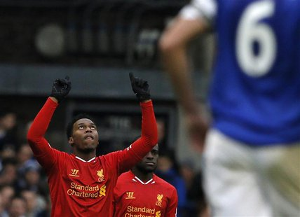 Liverpool's Daniel Sturridge (C) celebrates after scoring a goal against Everton during their English Premier League soccer match at Goodiso