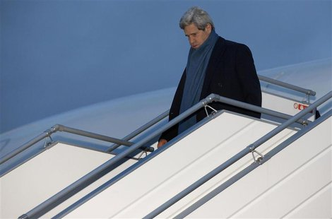 U.S. Secretary of State John Kerry walks down the steps of his aircraft as he arrives at Geneva International airport November 23, 2013. REU