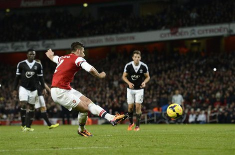 Arsenal's Olivier Giroud (C) scores a penalty against Southampton during their English Premier League soccer match at the Emirates stadium i