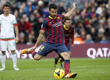 Barcelona's Cesc Fabregas scores from a penalty during their Spanish First division soccer match against Granada at Camp Nou stadium in Barc