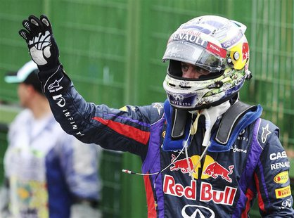 Red Bull Formula One driver Sebastian Vettel of Germany celebrates after taking pole position at the qualifying session of the Brazilian F1