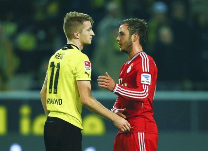Borussia Dortmund's Marco Reus (L) and Bayern Munich's Mario Goetze chat after their German first division Bundesliga soccer match in Dortmu