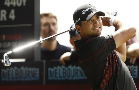 Australia's Jason Day plays a tee shot on the 12th hole during the final round of the World Cup of Golf at The Royal Melbourne Golf Club in
