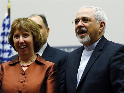 European Union foreign policy chief Catherine Ashton (L) smiles next to Iranian Foreign Minister Mohammad Javad Zarif during a ceremony at t