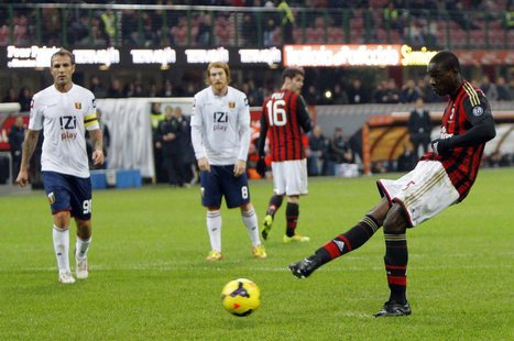 AC Milan's Mario Balotelli takes a penalty which was saved during their Italian Serie A soccer match against Genoa at San Siro stadium in Mi