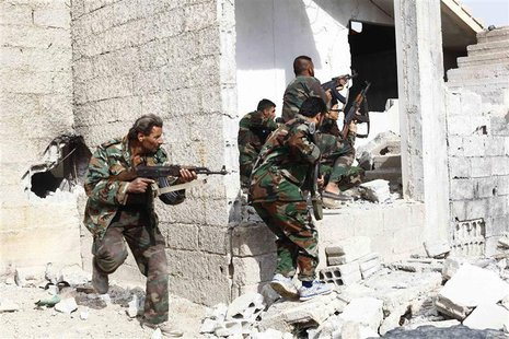 Shi'ite fighters, who support Syrian President Bashar al-Assad, search for rebels from house to house in the countryside near Damascus Novem