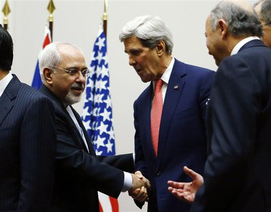 U.S. Secretary of State John Kerry (R) shakes hands with Iranian Foreign Minister Mohammad Javad Zarif after a ceremony at the United Nation