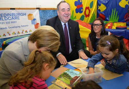 Scotland's First Minister Alex Salmond and Deputy First Minister Nicola Sturgeon (L) speak to pupils during a visit to North Edinburgh Child