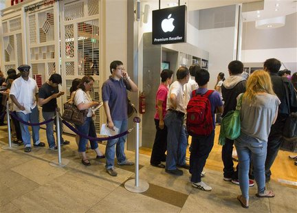 People line up outside an Apple reseller retail shop during the launch of the Apple iPad in Singapore in this July 23, 2010 file photo. REUT