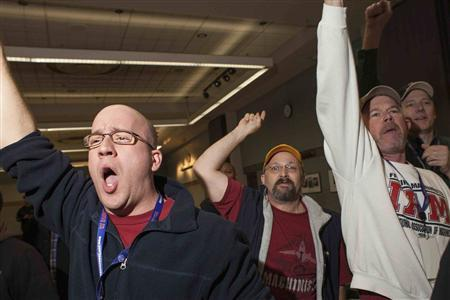 Union members celebrate after hearing the results of a union vote at the International Association of Machinists District 751 Headquarters in Seattle, Washington November 13, 2013.  CREDIT: REUTERS/DAVID RYDER