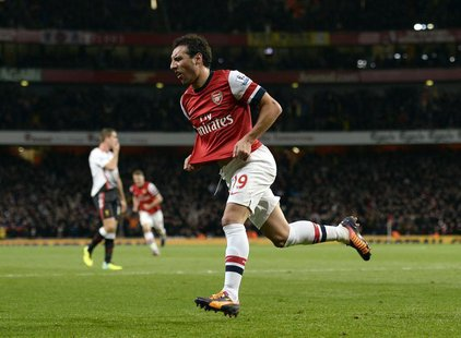 Arsenal's Santi Cazorla celebrates after scoring a goal against Liverpool during their English Premier League soccer match at the Emirates s