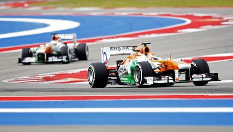 Force India Formula One driver Adrian Sutil of Germany (R) and Force India Formula One driver Paul di Resta of Britain drive during the thir
