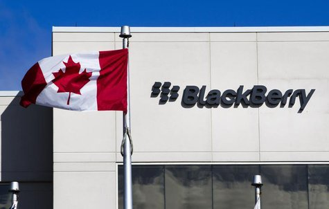 A Canadian flag waves in front of a Blackberry logo at the Blackberry campus in Waterloo, September 23, 2013. REUTERS/Mark Blinch
