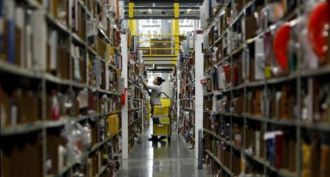 A worker gathers items for delivery from the warehouse floor at Amazon's distribution center in Phoenix, Arizona November 22, 2013. REUTERS/