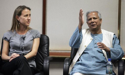 Panelists Anne Wojcicki, co-founder of 23and Me Inc. and 2006 Nobel Peace Prize Laureate Muhammad Yunus (R), managing director, Grameen Bank