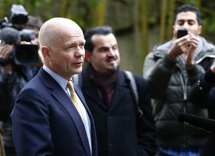 British Foreign Secretary William Hague talks to media after his arrival at the Intercontinental Hotel in Geneva November 23, 2013. REUTERS/