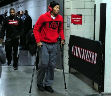Nov 22, 2013; Portland, OR, USA; Chicago Bulls point guard Derrick Rose (1) walks out of the Moda Center on crutches after being injured in