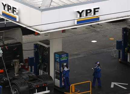 Employees work at a YPF gas station in Buenos Aires May 23, 2013. REUTERS/Marcos Brindicci