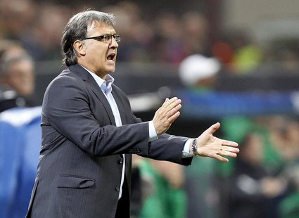 Barcelona's coach Gerardo Martino reacts during their Champions League soccer match against AC Milan at the San Siro stadium in Milan, Octob