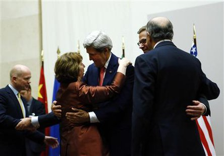 U.S. Secretary of State John Kerry (3rd R) hugs European Union foreign policy chief Catherine Ashton after she delivered a statement during a ceremony next to British Foreign Secretary William Hague (L), Germany's Foreign Minister Guido Westerwelle (R) and French Foreign Affairs Minister Laurent Fabius at the United Nations in Geneva November 24, 2013.  Credit: Reuters/Denis Balibouse