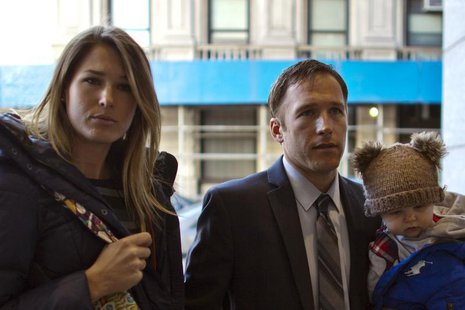 Olympic alpine skier Bode Miller arrives with his wife Morgan and his son at Manhattan's Family Court in New York, November 25, 2013. REUTER