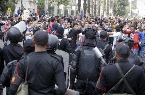 Students of Cairo University, who are supporters of the Muslim Brotherhood and ousted Egyptian President Mohamed Mursi, shout slogans agains