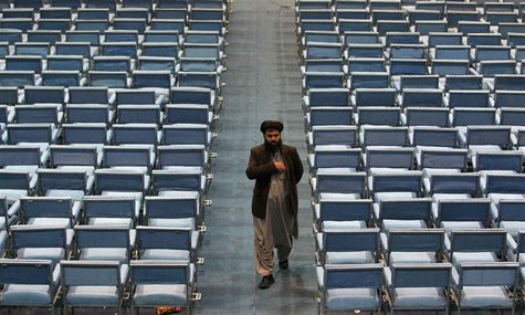 A member of the Loya Jirga, grand council, leaves on the last day of the Loya Jirga, in Kabul November 24, 2013. REUTERS/Omar Sobhani