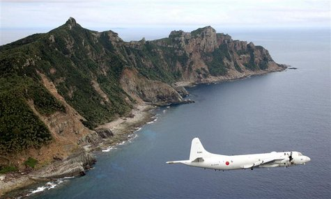 Japan Maritime Self-Defense Force's PC3 surveillance plane flies around the disputed islands in the East China Sea, known as the Senkaku isl