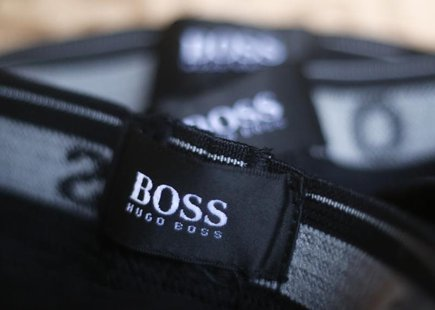 The logo of German fashion house Hugo Boss is seen on a clothing label at their outlet store in Mezingen near Stuttgart October 29, 2013. RE